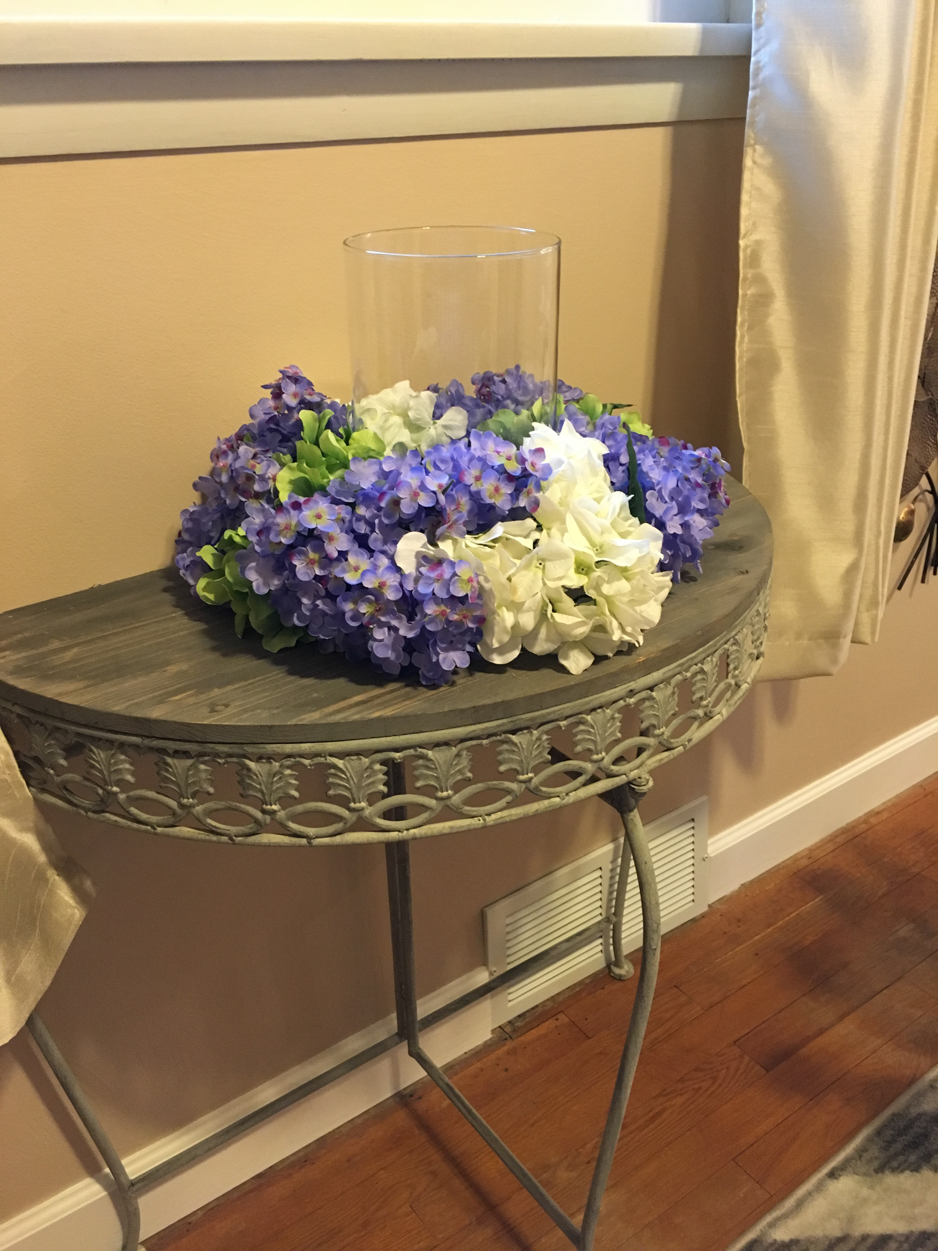 Floral centerpiece hydrangeas and lilacs
